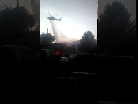 Helicopter water drop during Tick Fire Santa Clarita