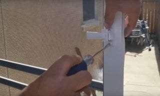 Screwing in screen door handle